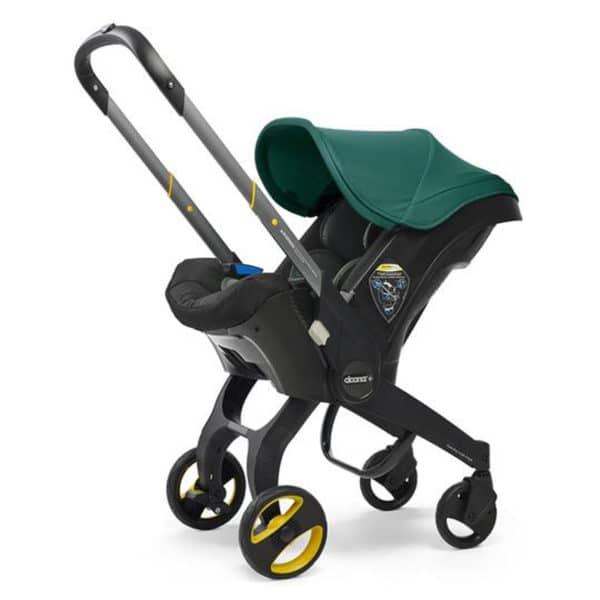 Doona+ Die Babyschale mit integriertem Travelsystem green